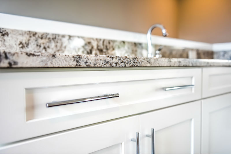 granite-counter-white-cabinets