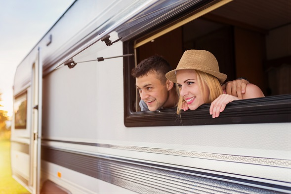 graphicstock-beautiful-young-couple-sitting-in-a-camper-van-on-a-summer-day_BRKdgapbZ